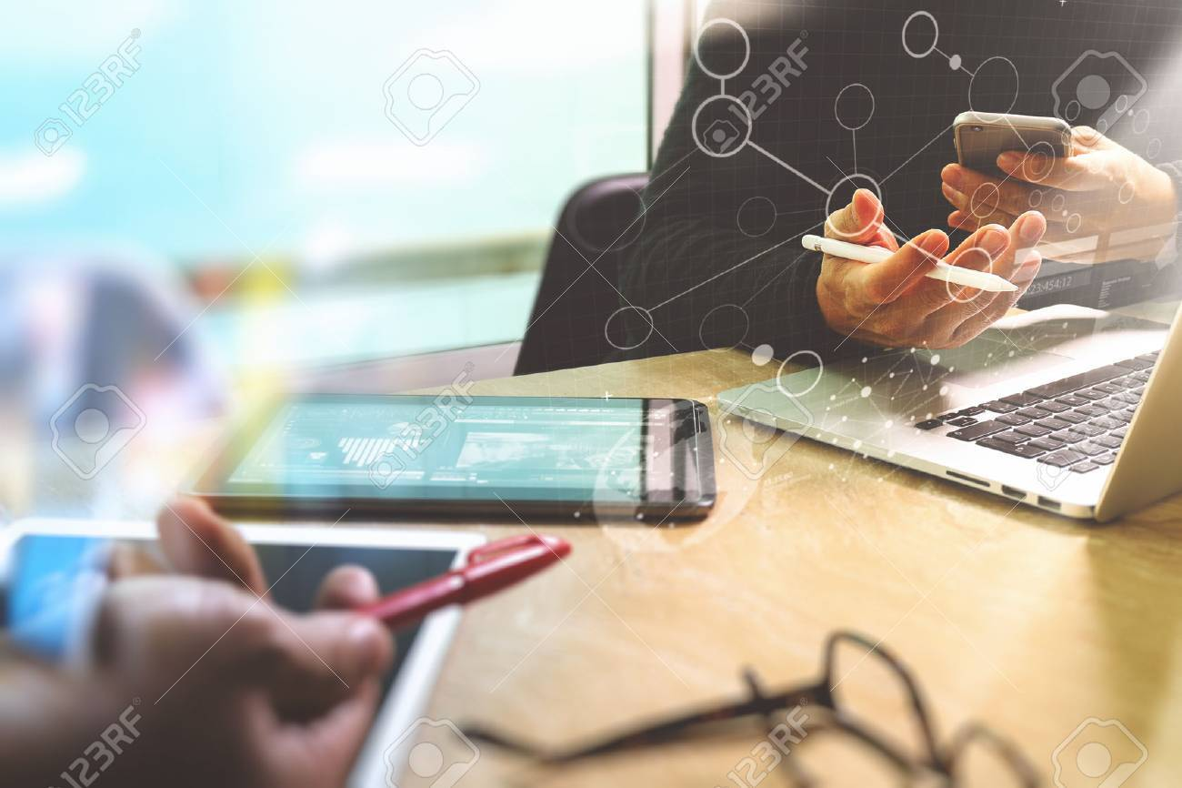 Photo website graphic designer hand meeting team with new project modern studio.Modern laptop digital tablet smart phone on marble table.Books papers documents, sun flare effect - 68505261