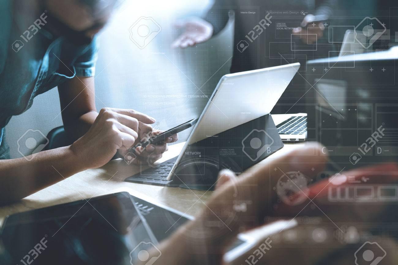 StartUp Programming Team. Website designer working digital tablet dock keyboard and computer laptop with smart phone and compact server on mable desk,light effect Standard-Bild - 66958180