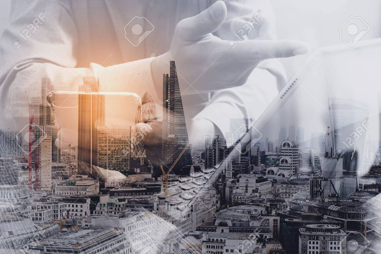 Double exposure of success businessman using smart phone,digital tablet docking smart keyboard with London building,city,omnichannel - 68573863