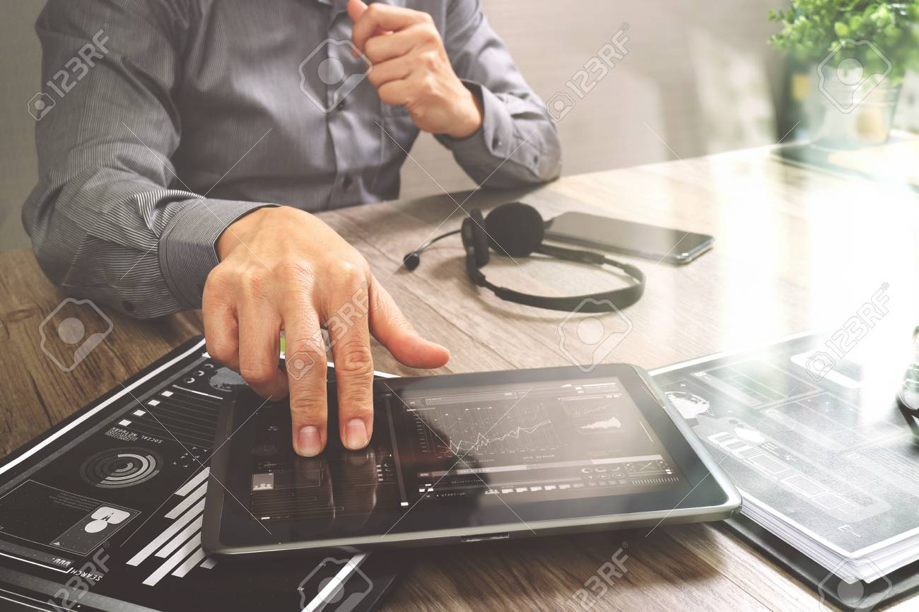 Businessman hand using VOIP headset with digital tablet computer,document,concept communication, it support, call center and customer service help desk,filter effect - 72175426