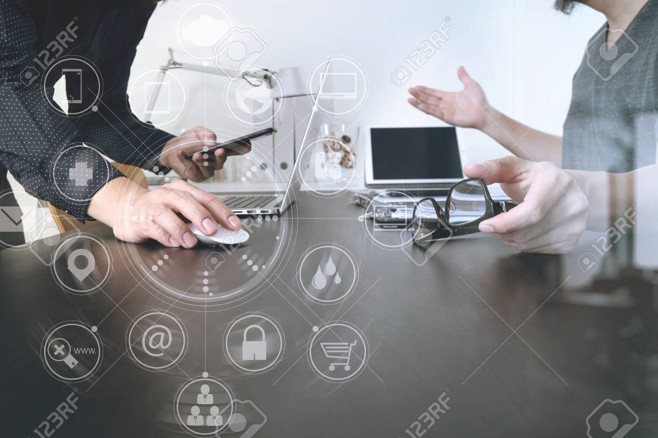 Business team meeting.Professional investor working new start up project and digital tablet docking keyboard and laptop computer with smart phone using and eyeglasses in modern office with virtual interface graphic icons network diagram - 72426702