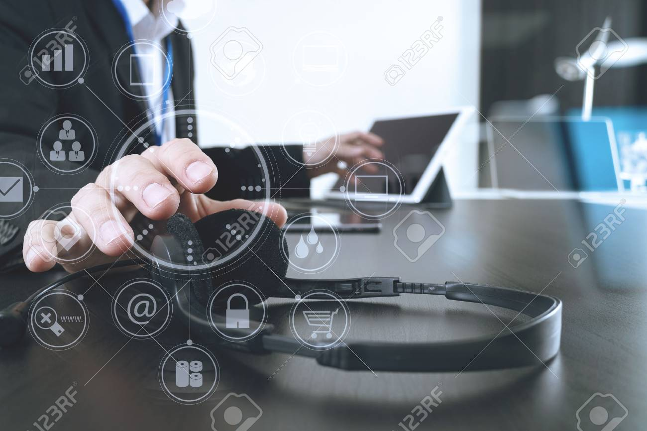 Man using VOIP headset with digital tablet and laptop computer as concept communication,it support,call center and customer service help desk with virtual icon diagram - 76802840