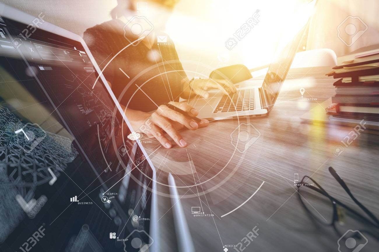 businessman working with mobile phone and digital tablet and laptop computer on wooden desk in modern office with virtual icon diagram - 76603415