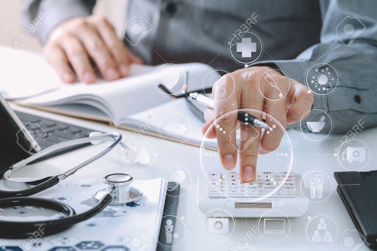 Healthcare costs and fees concept.Hand of smart doctor used a calculator for medical costs in modern hospital with VR icon diagram - 80116541