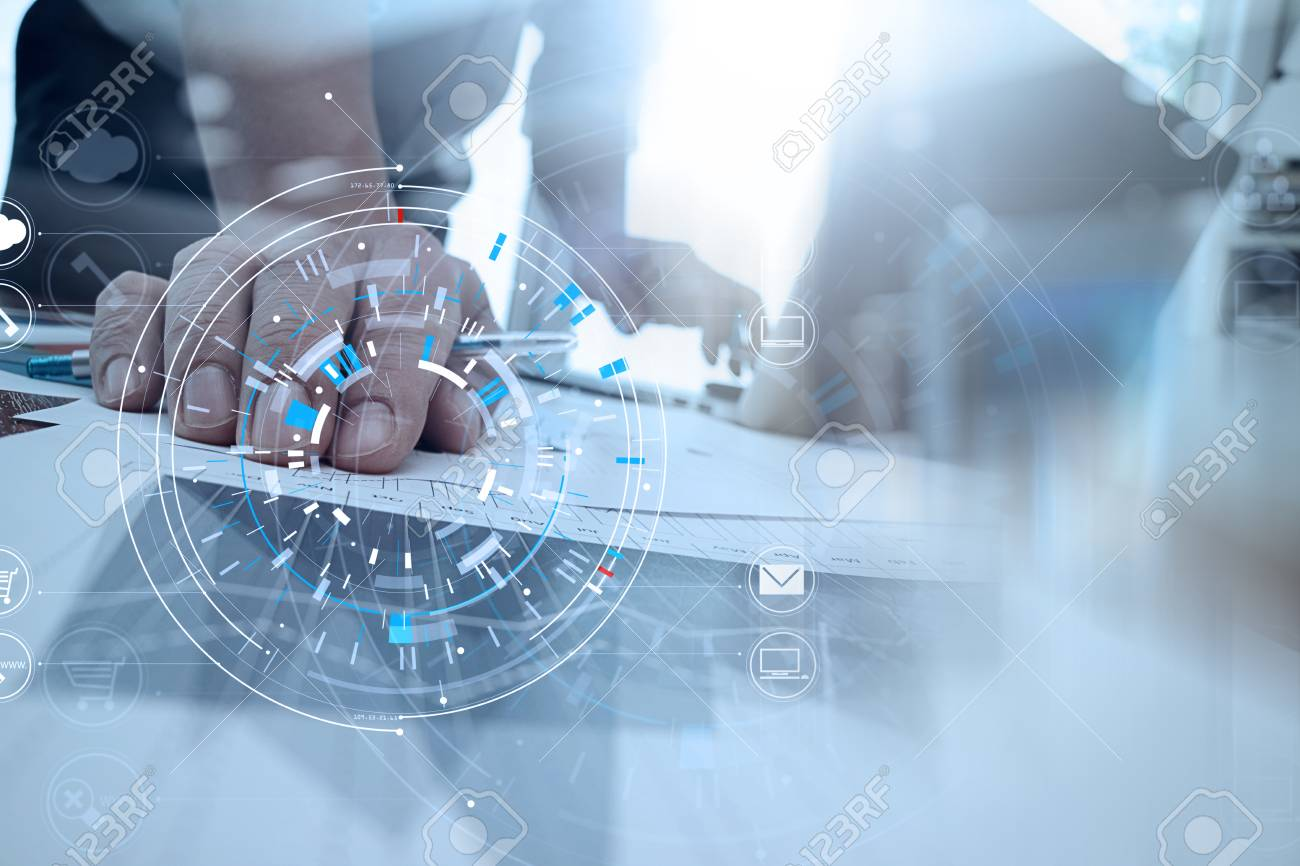 Hands of businessman using mobile phone in modern office with laptop and digital tablet computer in finance team meeting with VR icon diagram - 92775735
