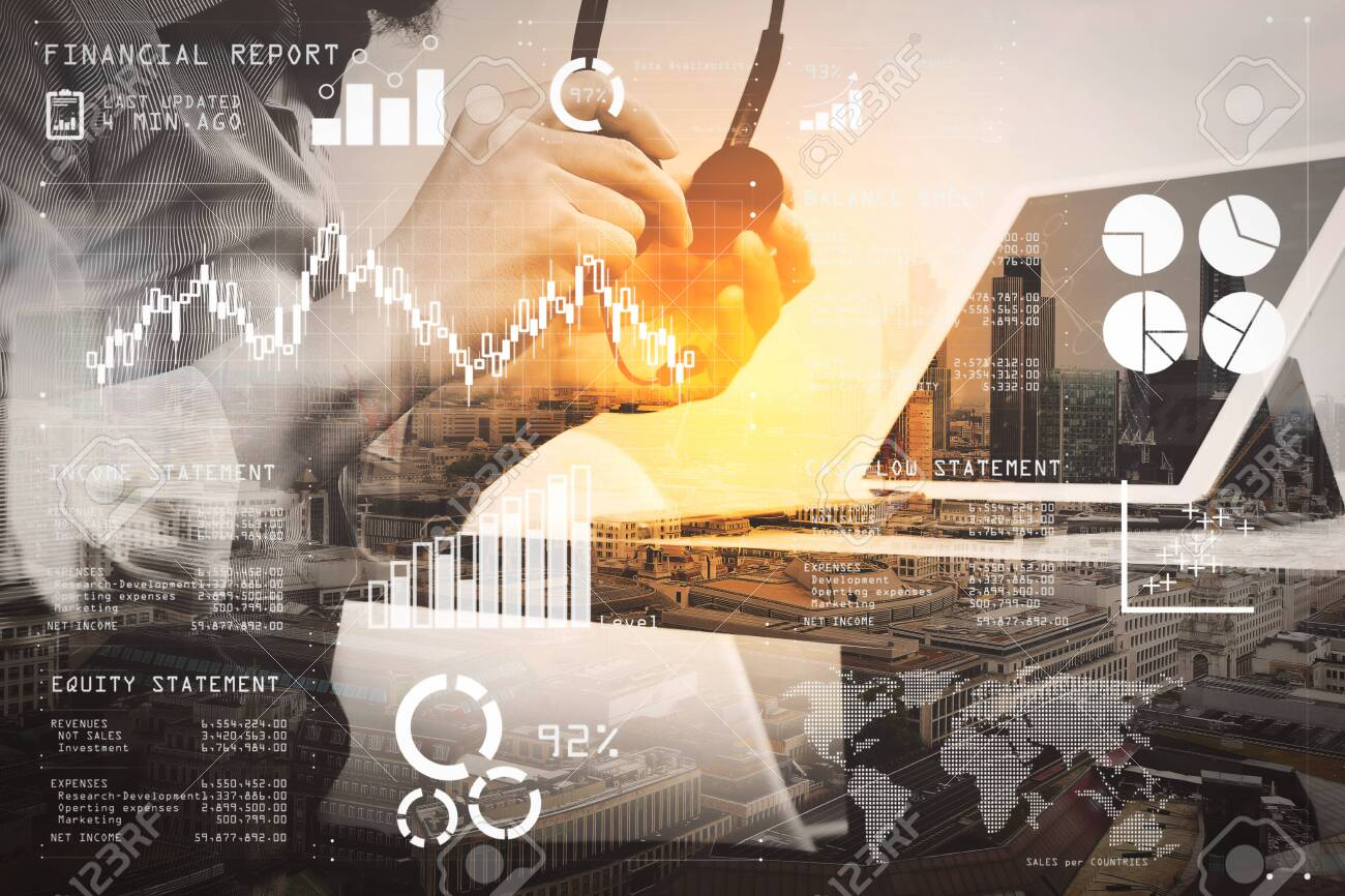 Financial report data of business operations (balance sheet and income statement and diagram) as Fintech concept.Double exposure of business man using VOIP headset with digital tablet computer. - 101015320