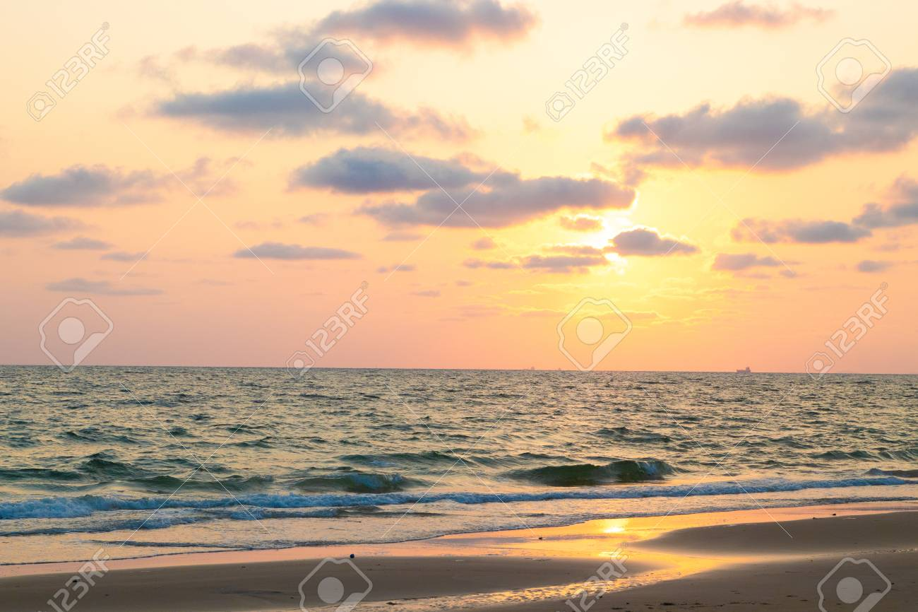 Beautiful pink sunset over sea on the beach, background