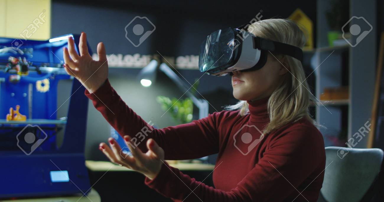 Woman wearing VR headset and designing model with hands while