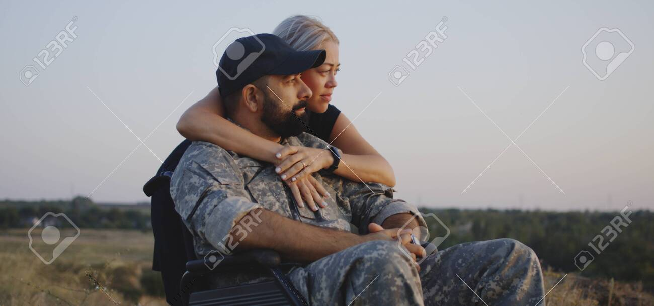 Medium Shot Of Wife Hugging Wheelchaired Soldier Husband Stock Photo Picture And Royalty Free Image Image 130672971