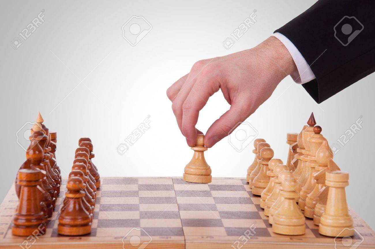 chess. The first step. hand chess and a chess board Stock Photo - 13186603