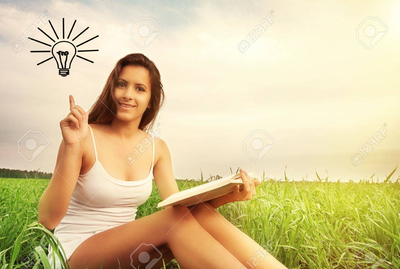 concept of education. beauty girl reading book outdoors Stock Photo - 14446527