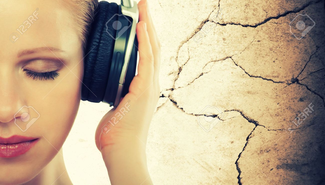 music concept. half of the face woman with headphones Stock Photo - 14721822
