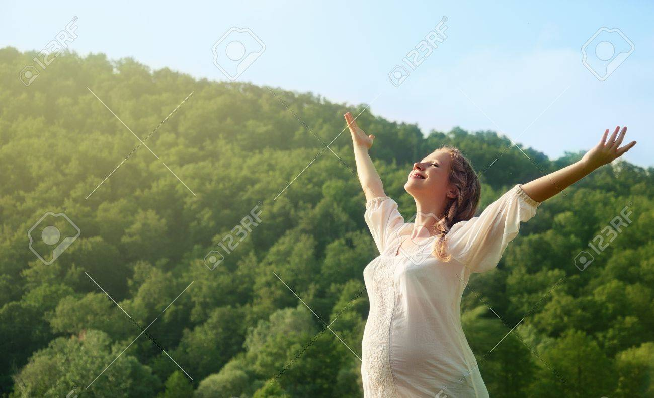 young pregnant woman enjoying life outdoors in summer Stock Photo - 15037563
