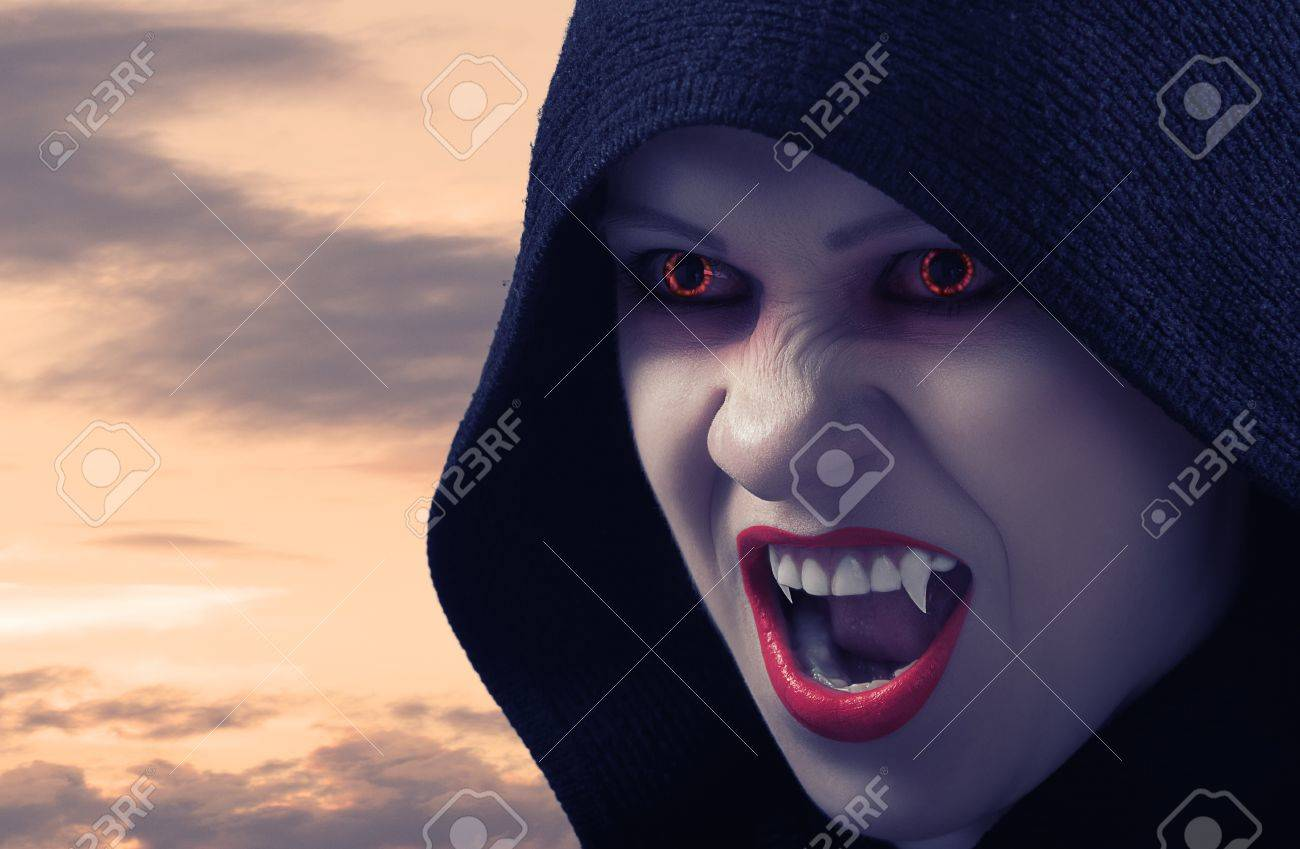 angry female vampire at sunset and moon Stock Photo - 15361835