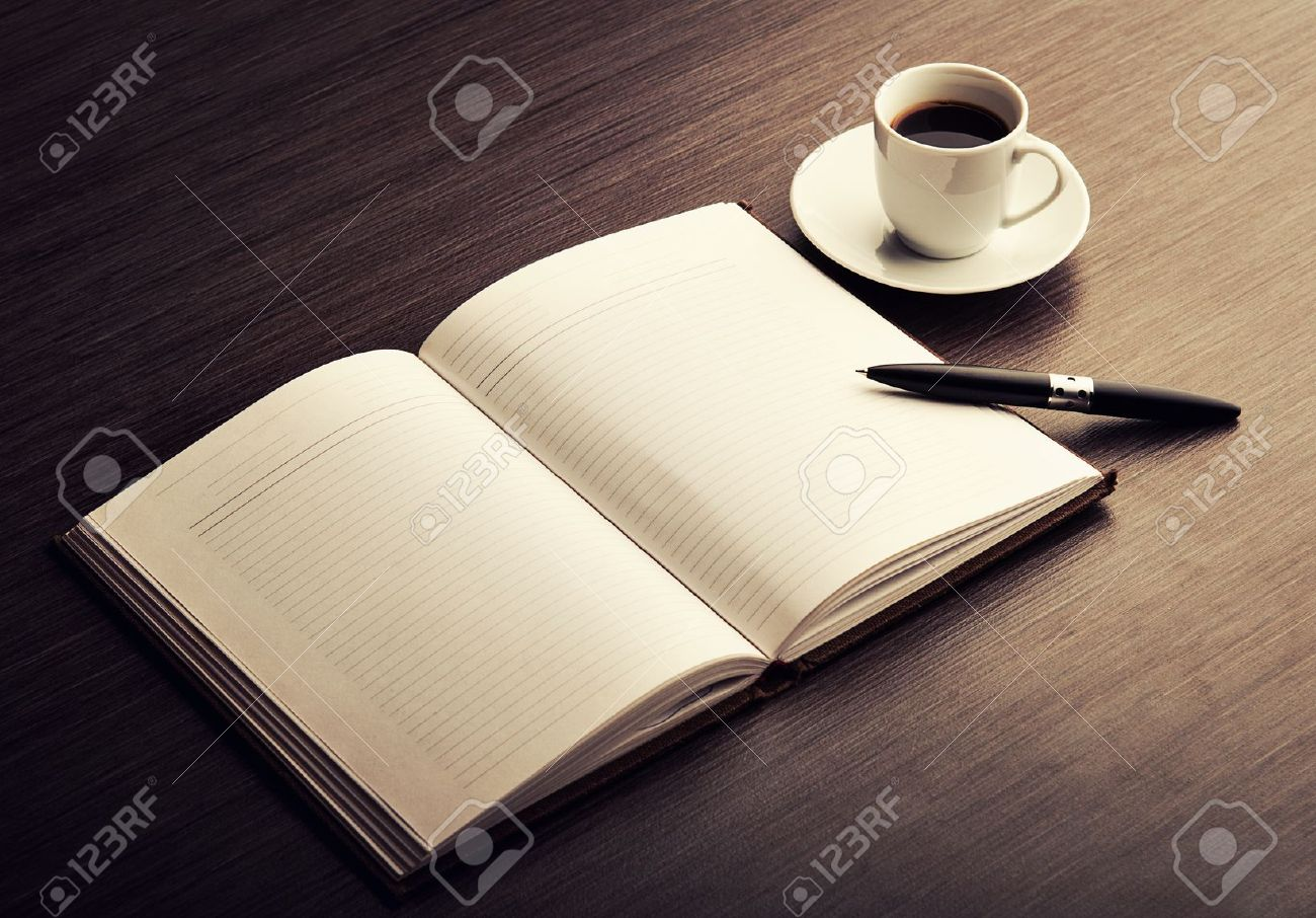 Open a blank white notebook, pen and cup of coffee on the desk Stock Photo - 17693241