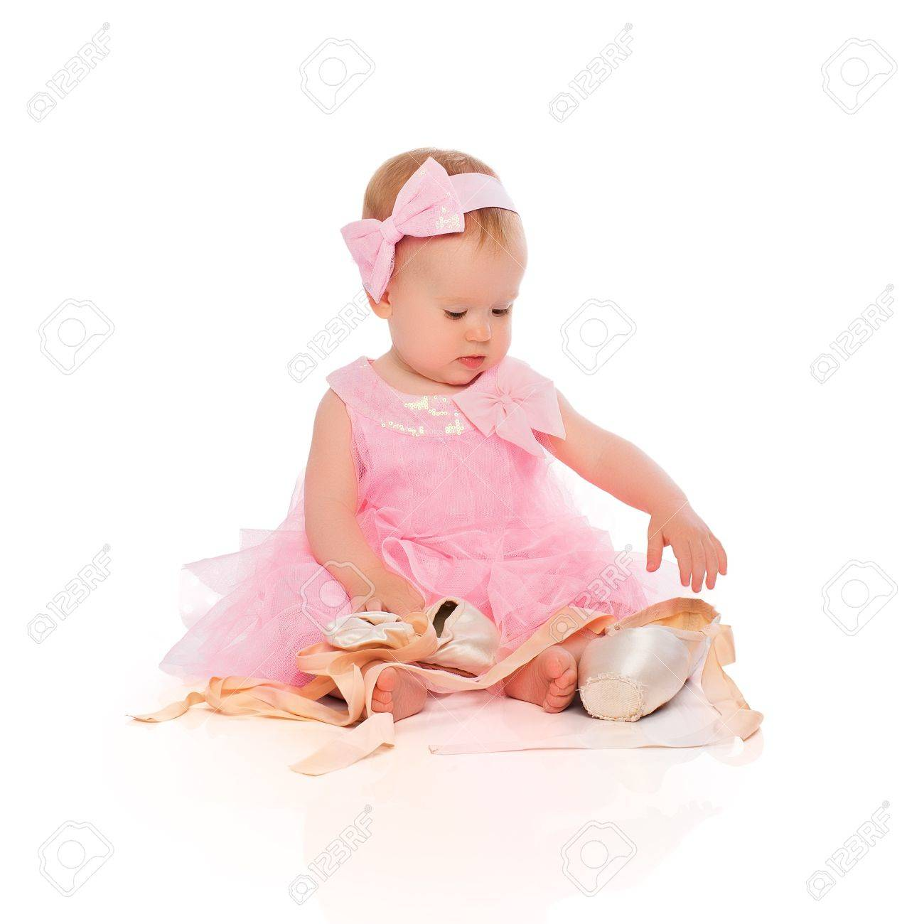 6d6604254142 Little Baby Girl In A Pink Ballerina Dress With Pointe Shoes.. Stock ...