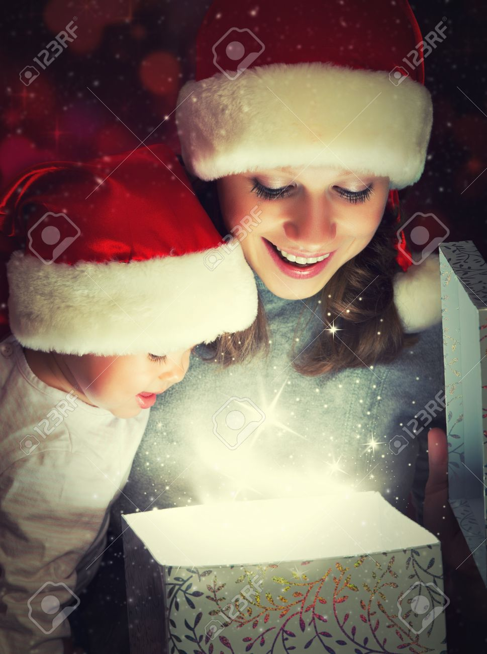 Christmas magic gift box and a woman happy family mother and Child baby Stock Photo - 22220628