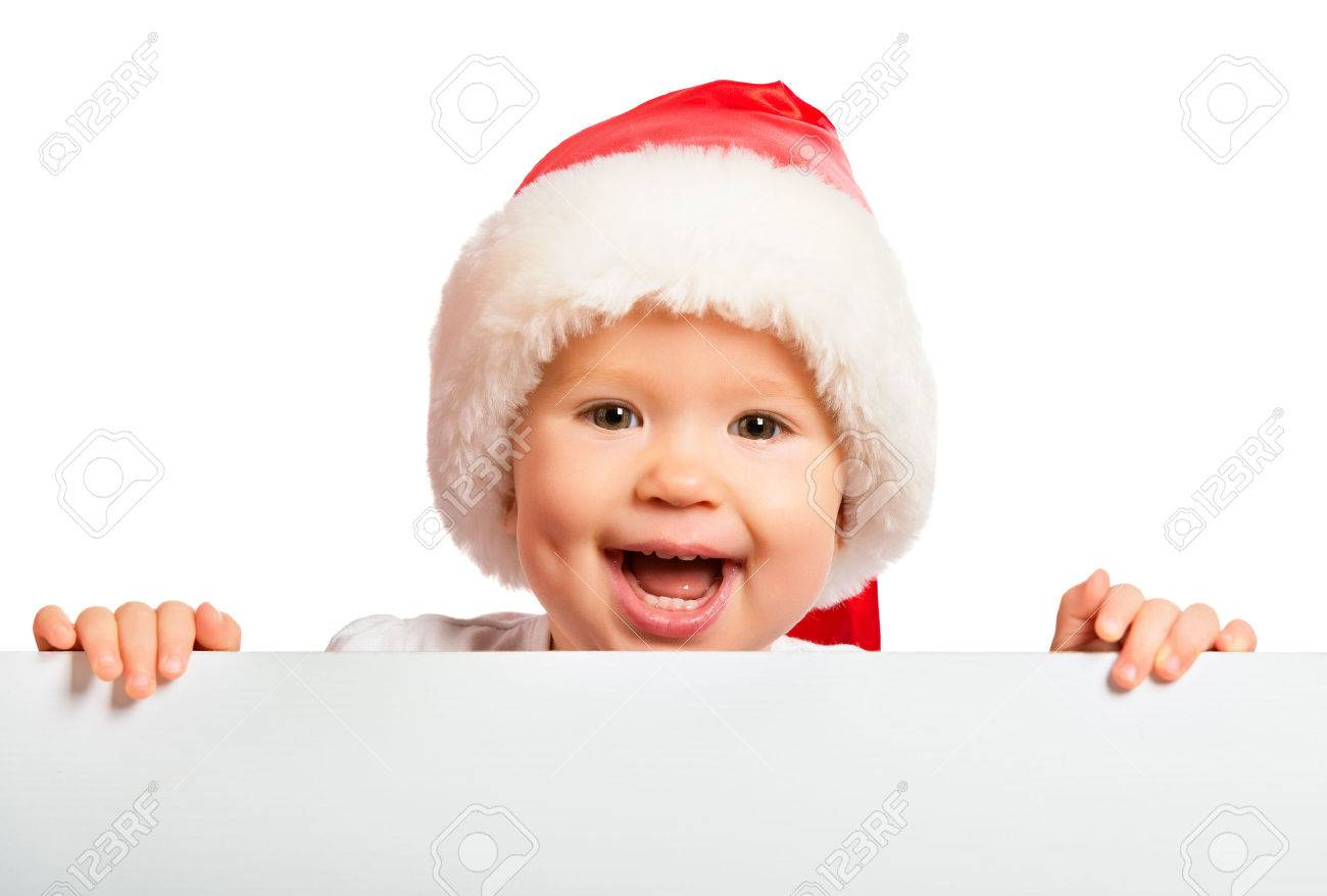 9e5b629cada happy baby in a Christmas hat and a blank billboard isolated on white  background Stock Photo