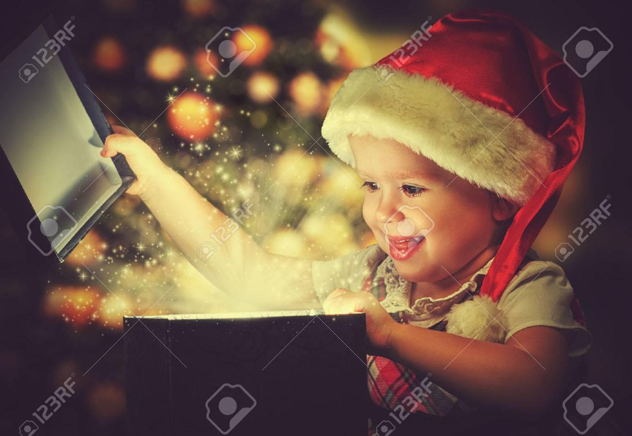 Christmas miracle, magic gift box and a child baby girl - 32987305
