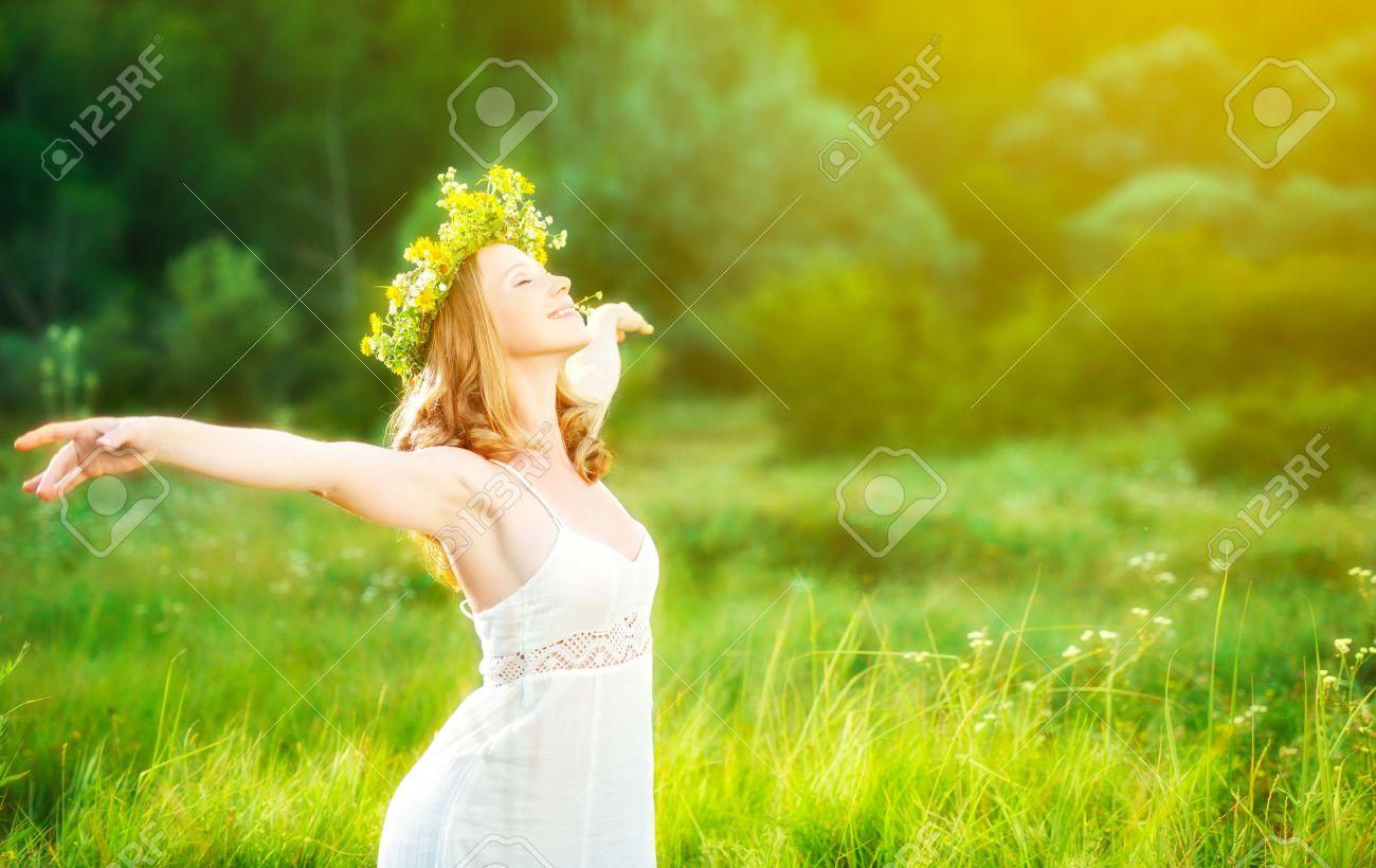 happy woman in wreath outdoors summer enjoying life opening hands - 39653069