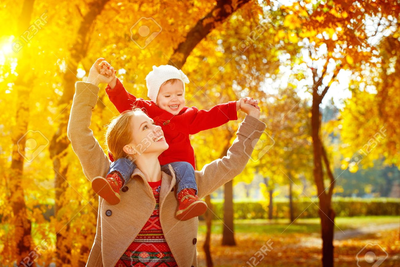 happy family: mother and child little daughter play cuddling on autumn walk in nature outdoors Stock Photo - 43152201