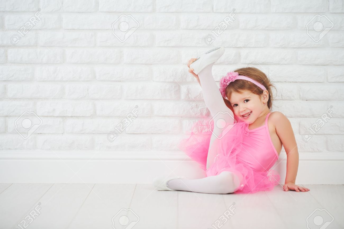 child little girl dancer ballet ballerina stretching stock photo
