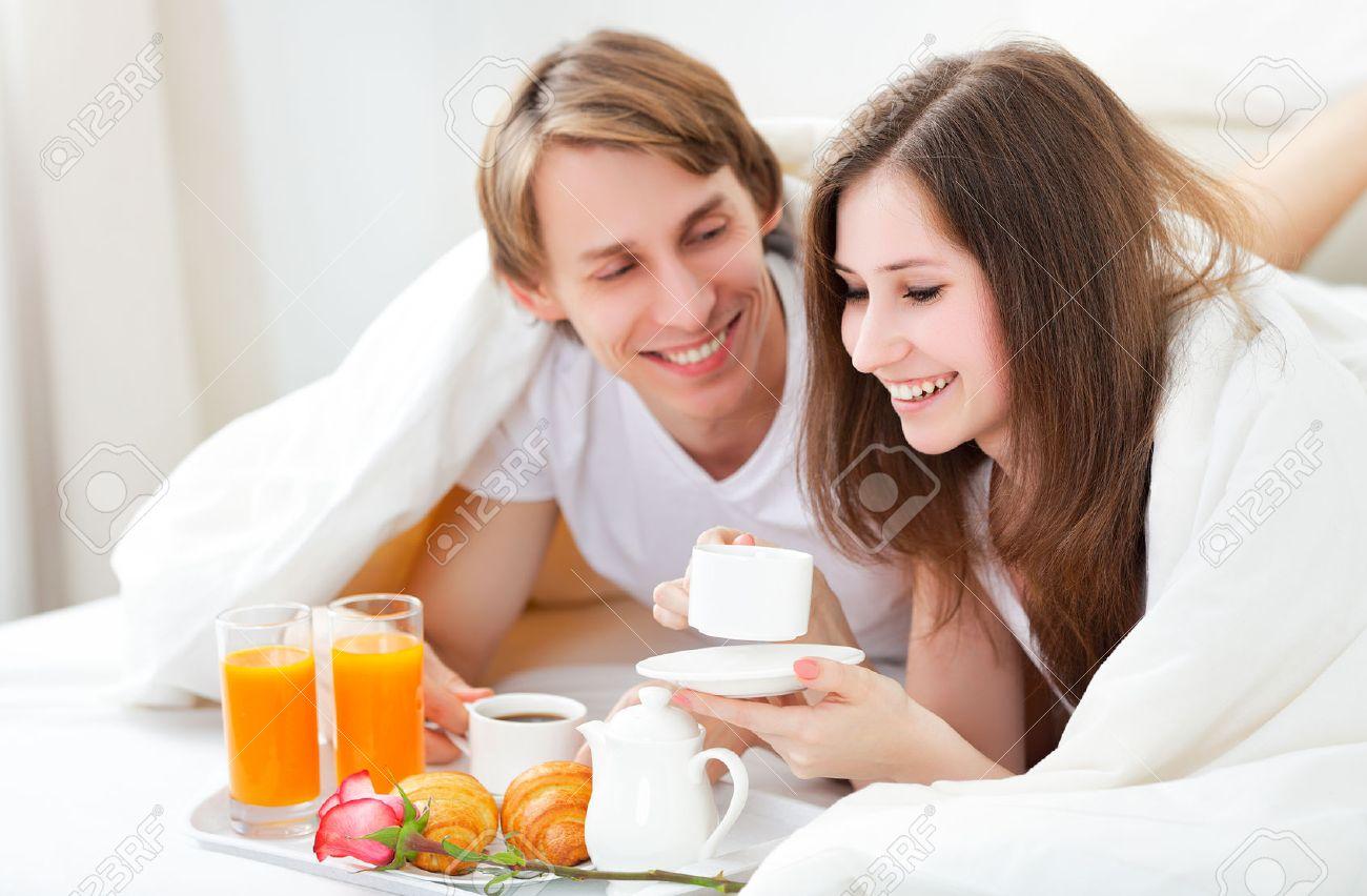 loving couple having breakfast in bed on Valentine's Day Stock Photo - 50842833