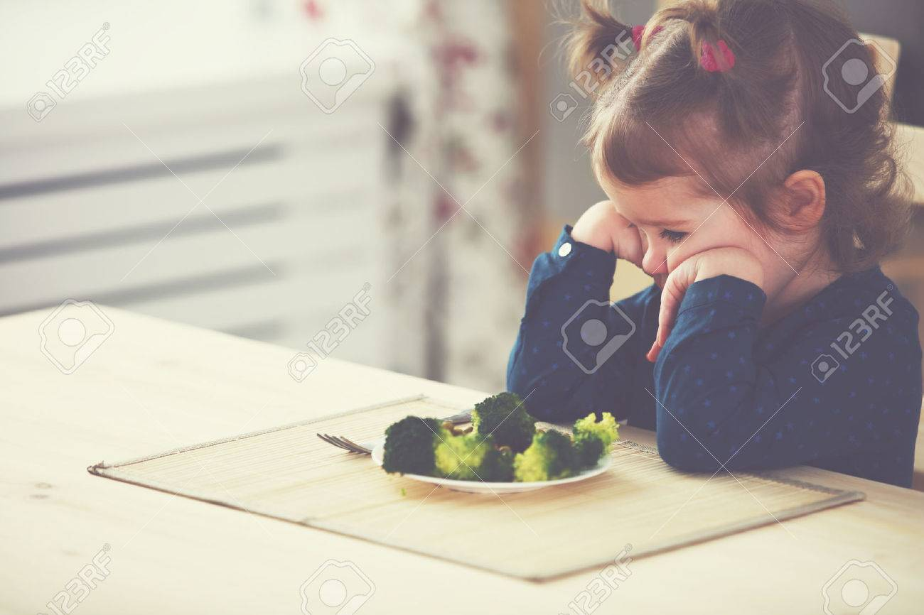child girl does not like and does not want to eat vegetables - 51837559