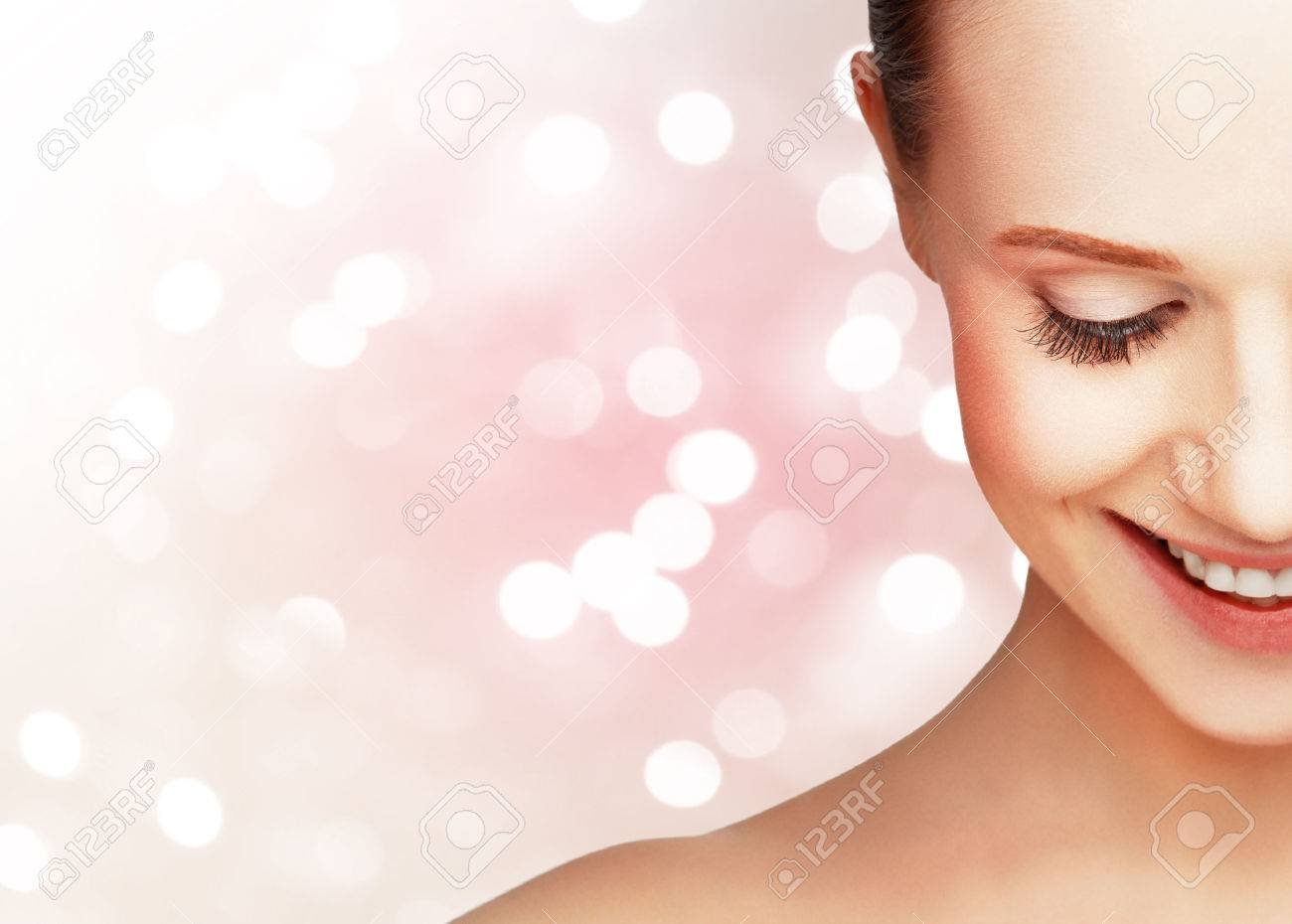 half laughing face of a beautiful healthy woman - 53678461