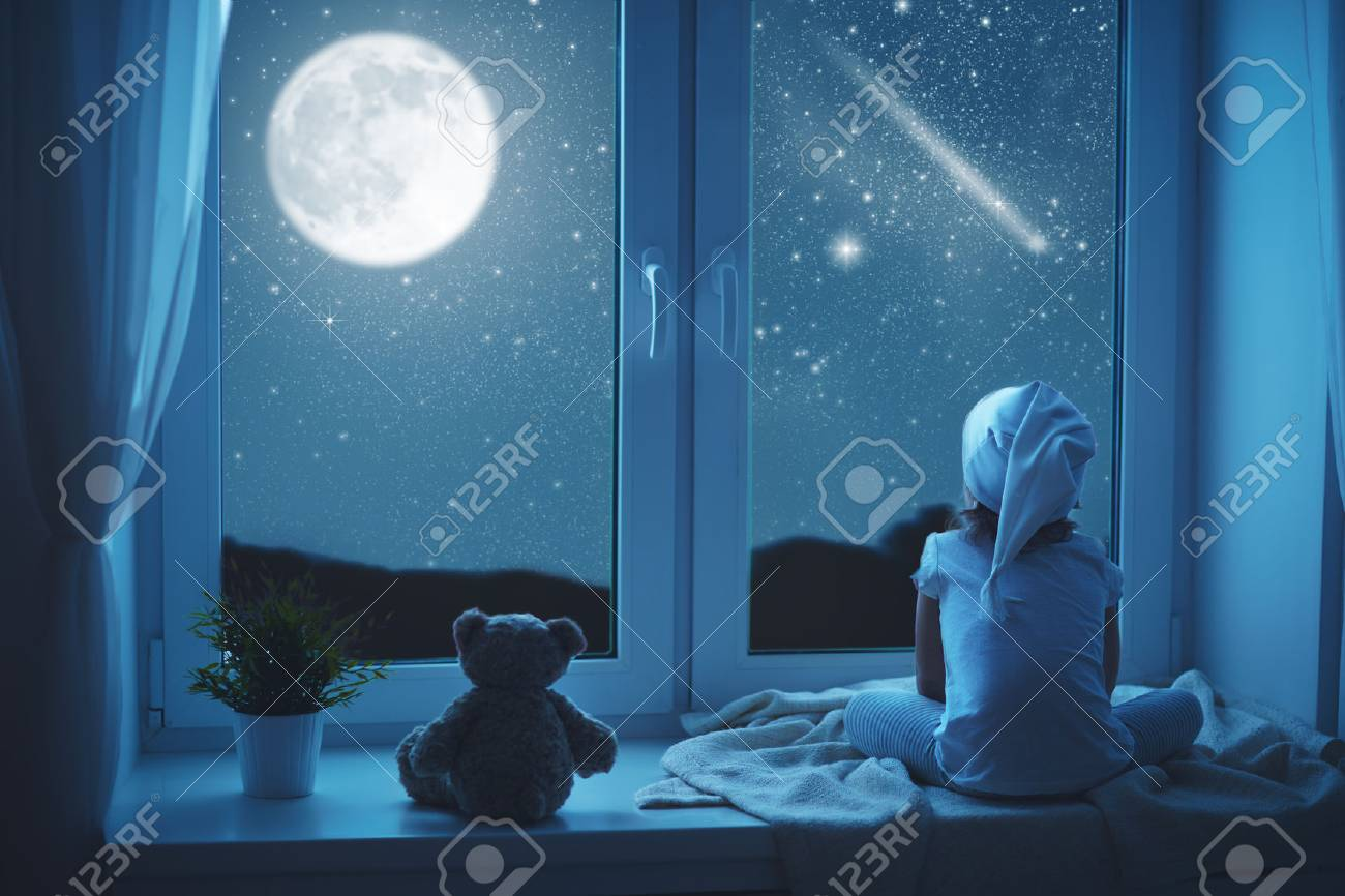 child little girl at the window dreaming and admiring the starry sky at bedtime night - 55011076