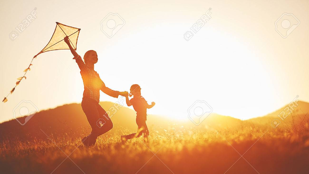 happy family mother and child run on meadow with a kite in the summer on the nature - 59310648