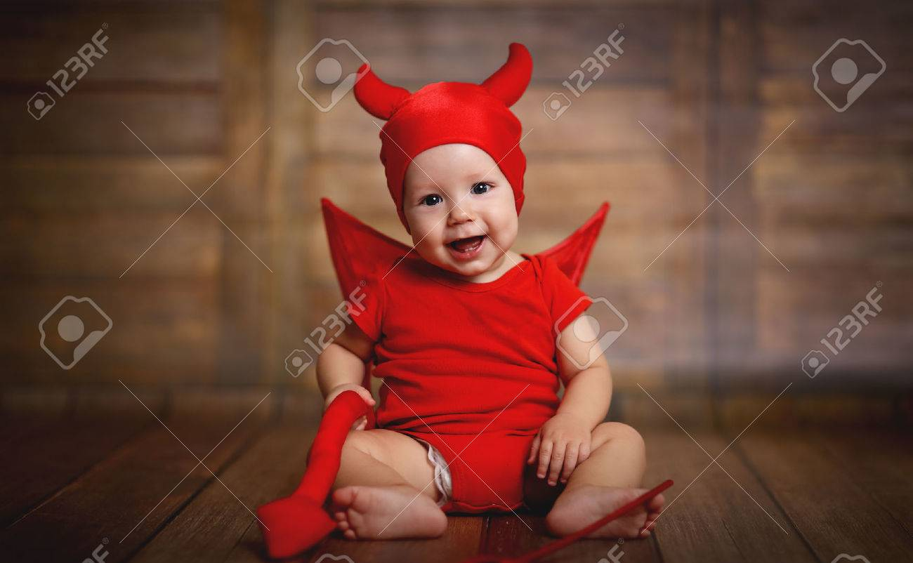 funny baby in devil halloween costume with horns on a dark wooden background Stock Photo -  sc 1 st  123RF.com & Funny Baby In Devil Halloween Costume With Horns On A Dark Wooden ...