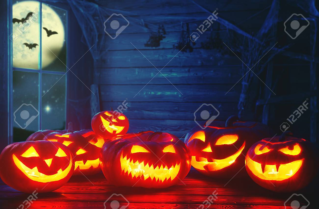 63076991 spooky halloween background scary pumpkin with burning eyes and smiles in the night