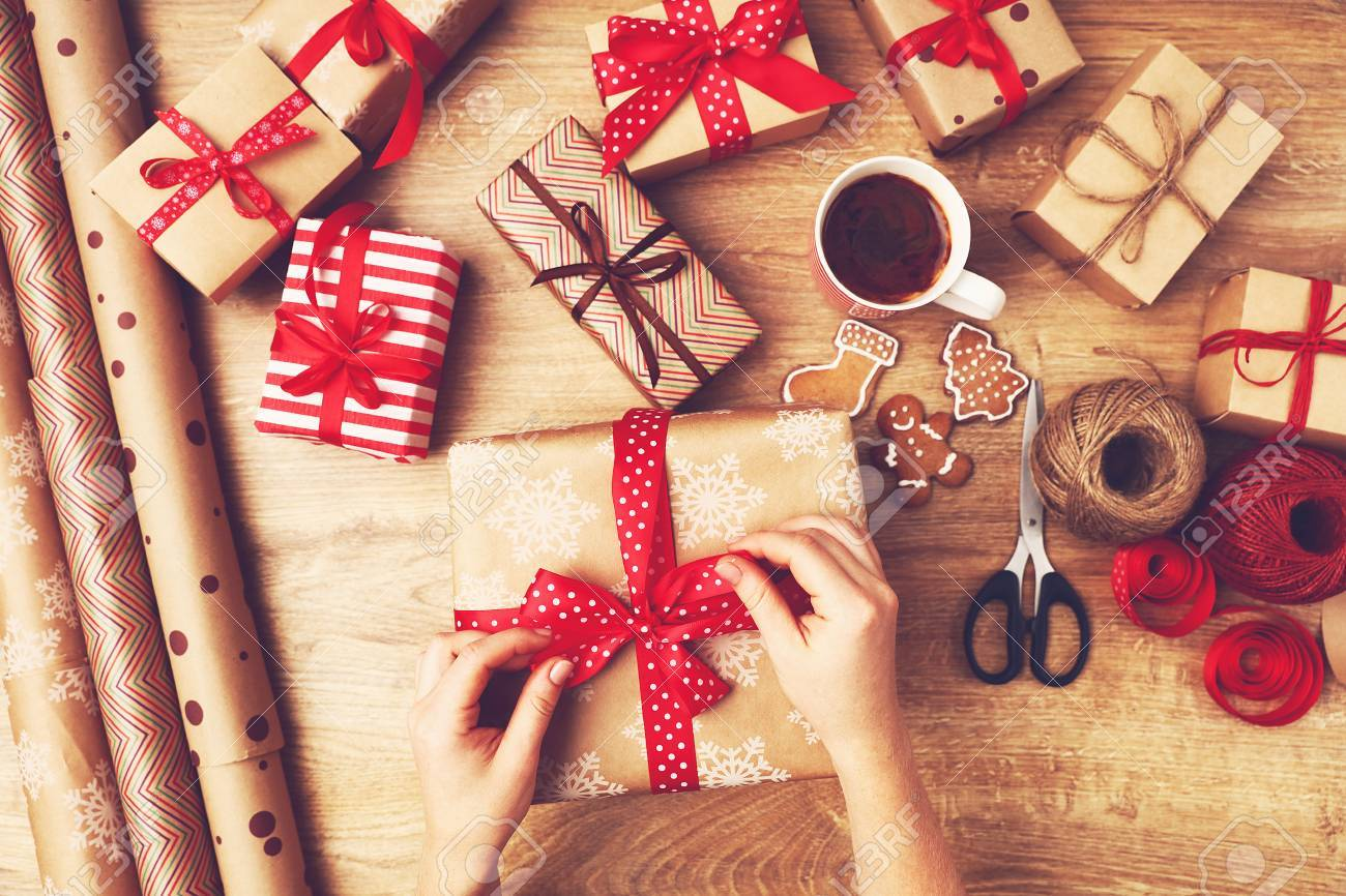 Hand Of Woman Packs Boxes With Christmas Gifts Presents On A.. Stock ...
