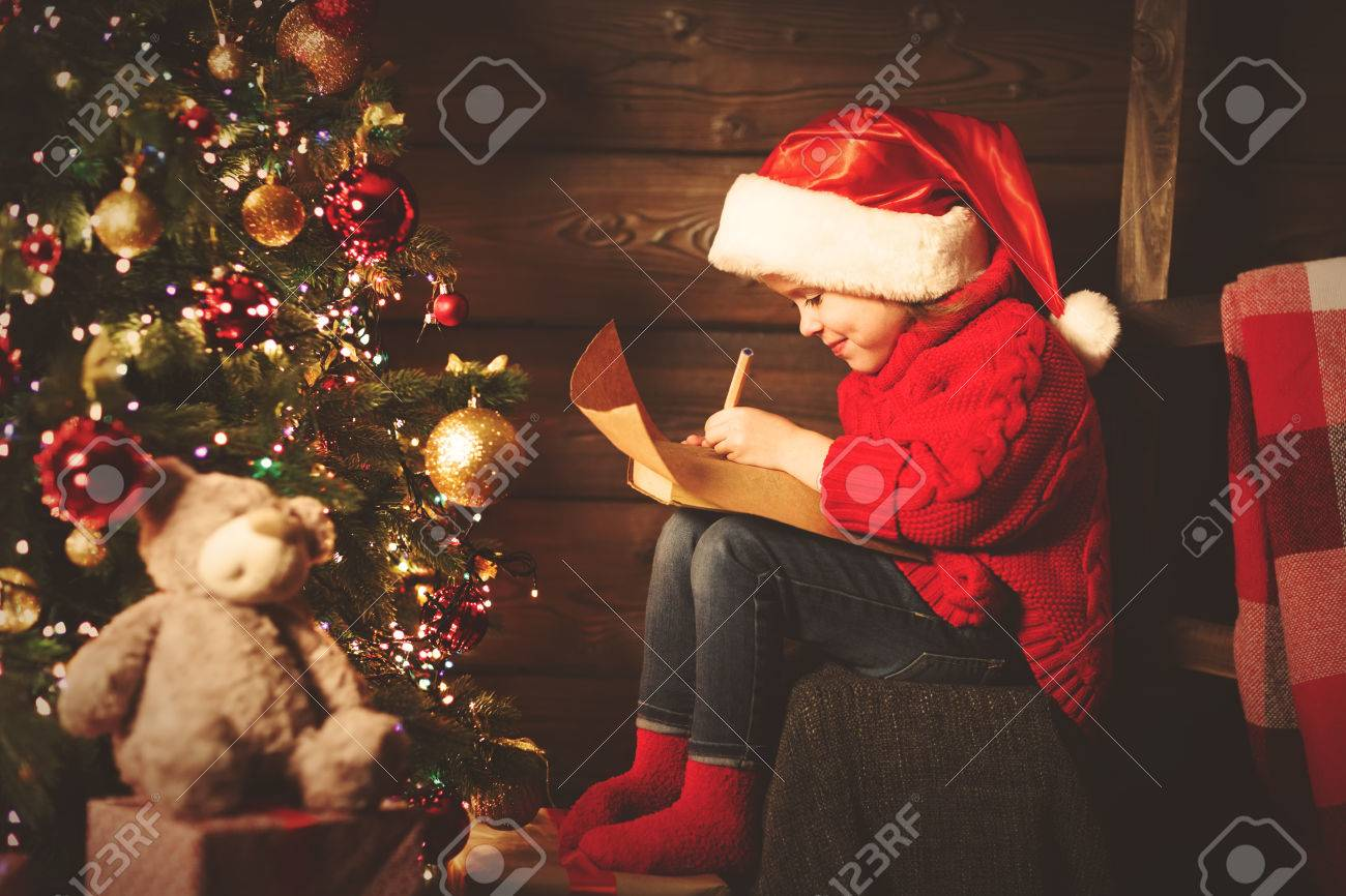 Happy Child Girl Writes Letter To Santa Claus At The Christmas