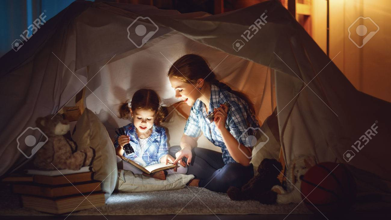 Flashlight stock photos royalty free flashlight images reading and family games in childrens tent mother and child daughter with book and flashlight sciox Gallery