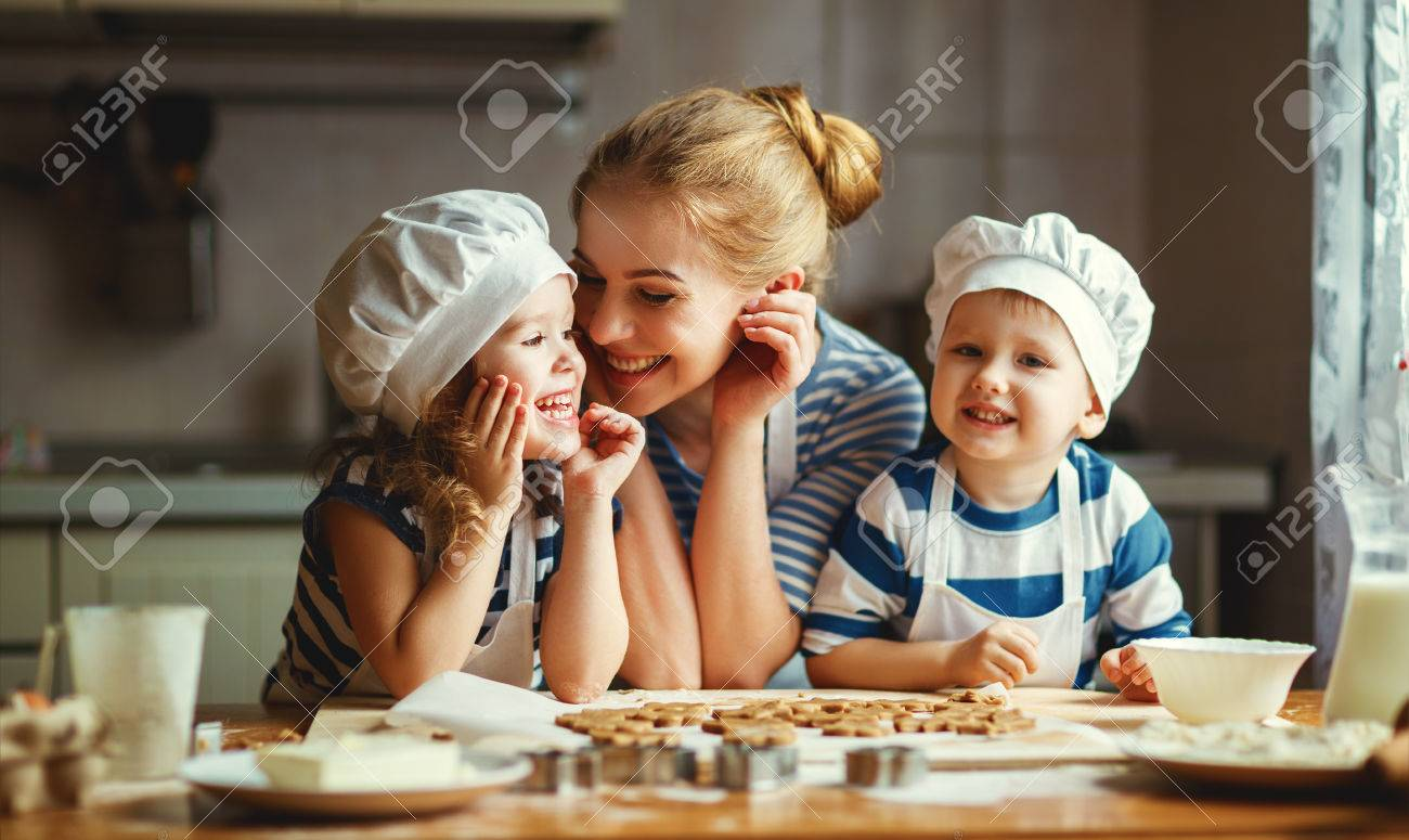 happy family in the kitchen. mother and  children preparing the dough, bake cookies Foto de archivo - 70105355