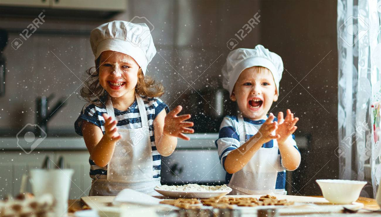 happy family funny kids are preparing the dough, bake cookies in the kitchen - 70657988