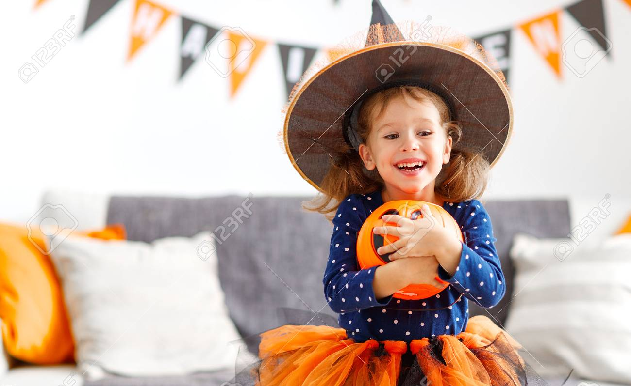 happy laughing child girl in witch costume to halloween - 85924124