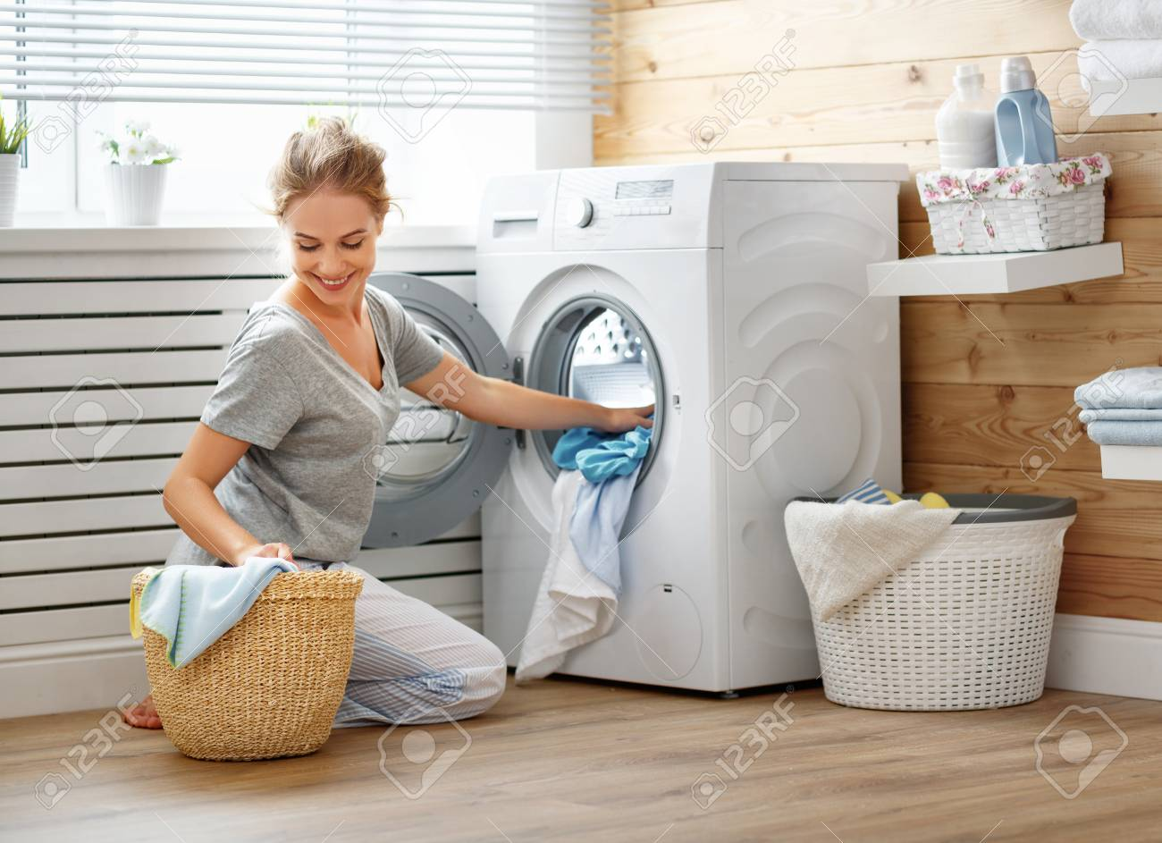 A Happy Housewife Woman In Laundry Room With Washing Machine Stock Photo,  Picture And Royalty Free Image. Image 93867833.