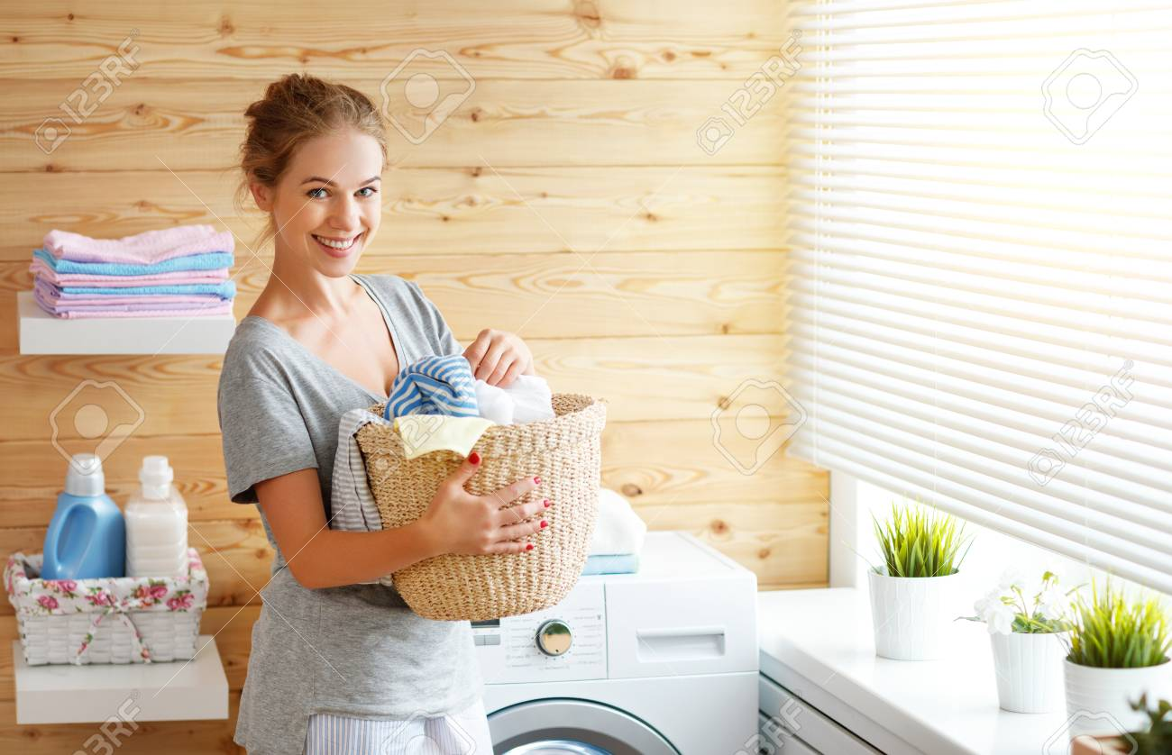 A Happy Housewife Woman In Laundry Room With Washing Machine Stock Photo,  Picture And Royalty Free Image. Image 93868209.