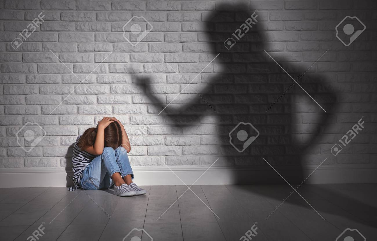 domestic violence. angry mother scolds frightened daughter sitting on floor - 93931136