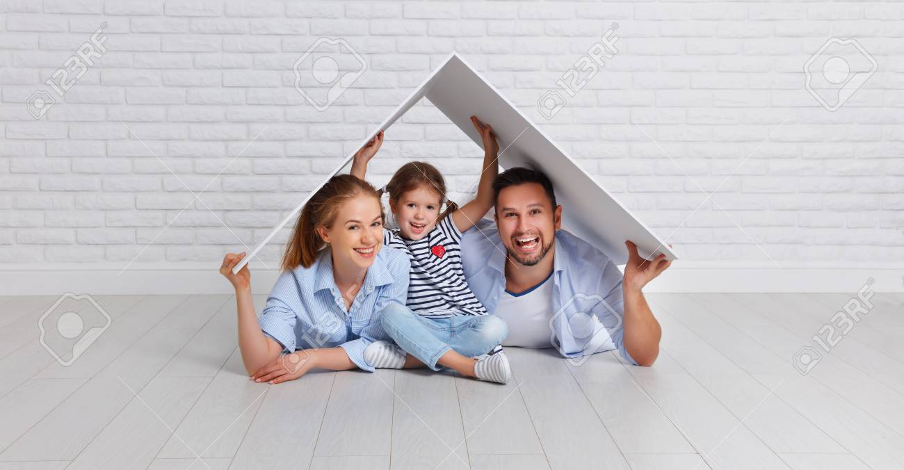 concept housing a young family. Mother father and child in new house with a roof at empty brick wall - 93931145