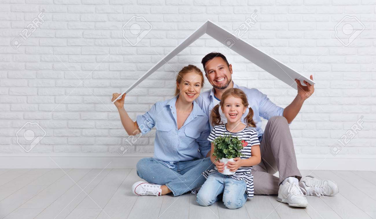 concept housing a young family. Mother father and child in new house with a roof at empty brick wall - 94317968