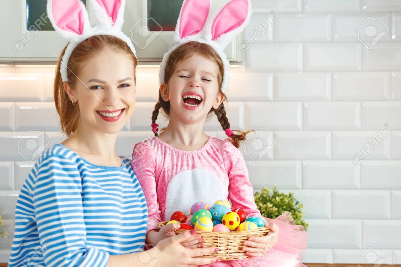 Happy easter! family mother and child daughter with ears hare getting ready for holiday - 97650066