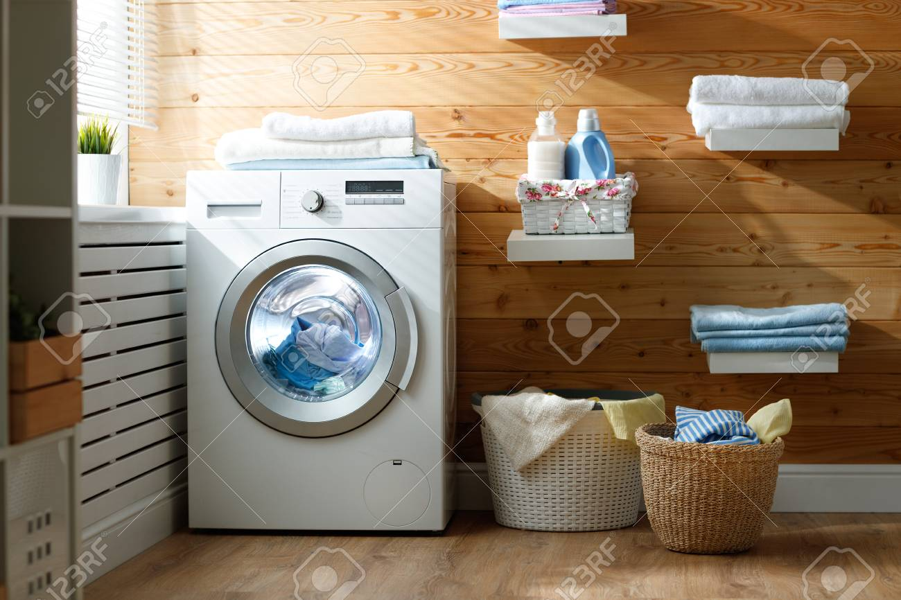 Interior of a real laundry room with a washing machine at the window at home - 98703637