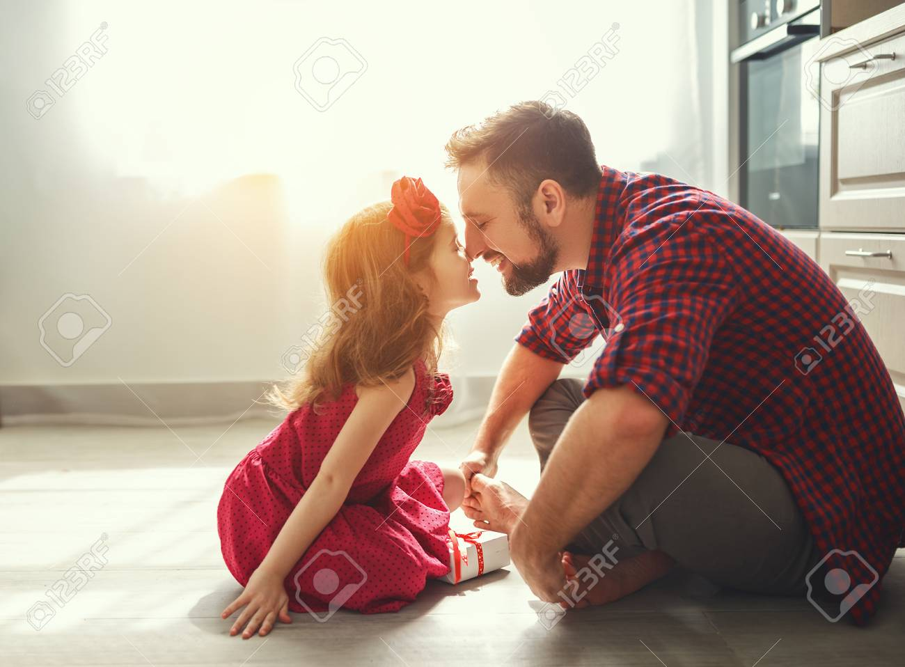 Father's day. Happy family daughter giving dad a greeting card on holiday - 99700402