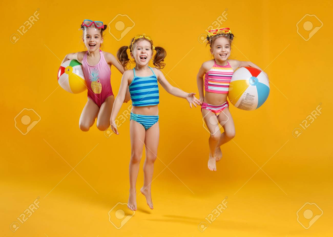26072a6af4 funny funny happy children jumping in swimsuit and swimming..