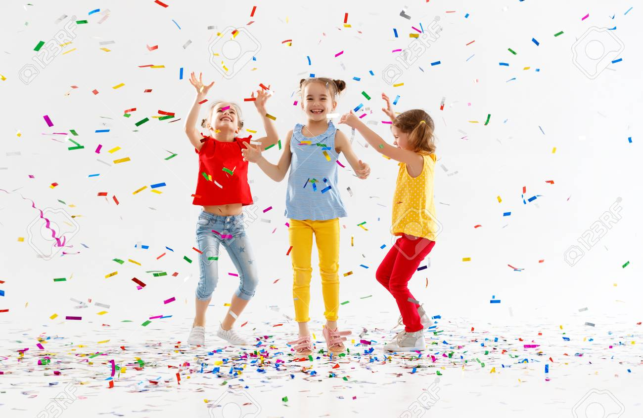 happy children on holidays have fun and jumping in multicolored confetti on white background - 100277506
