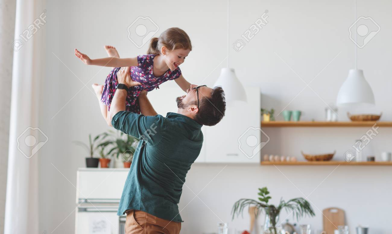 Father's day. Happy family daughter hugs his dad on holiday - 101019790